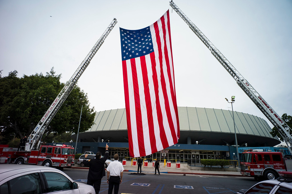 . A giant US flag at the memorial for slain TSA officer Gerardo Hernandez at the Los Angeles Sports Arena Tuesday, November 12, 2013.  A public memorial was held for Officer Hernandez who was killed at LAX when a gunman entered terminal 3 and opened fire with a semi-automatic rifle.  ( Photo by David Crane/Los Angeles Daily News )