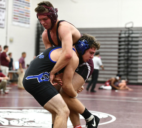1/4/2020 Mike Orazzi | StaffrBristol Central's Andrew Beaucar and Plainville's Kyle Voisine in a 160 match during Saturday's wrestling tournament at Bristol Central High School.
