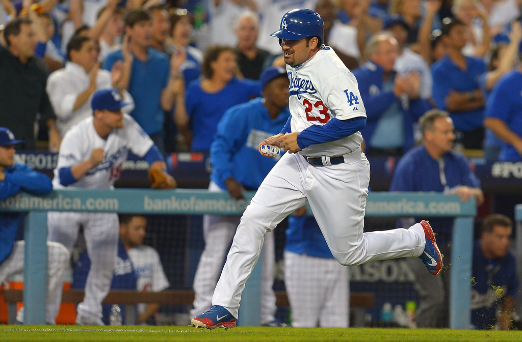 . The Dodgers\' Adrian Gonzalez scores after Yasiel Puig singled to center in the 4th against the Cardinals during game 4 of the NLCS at Dodger Stadium Tuesday, October 15, 2013. (Photo by Andy Holzman/Los Angeles Daily News)