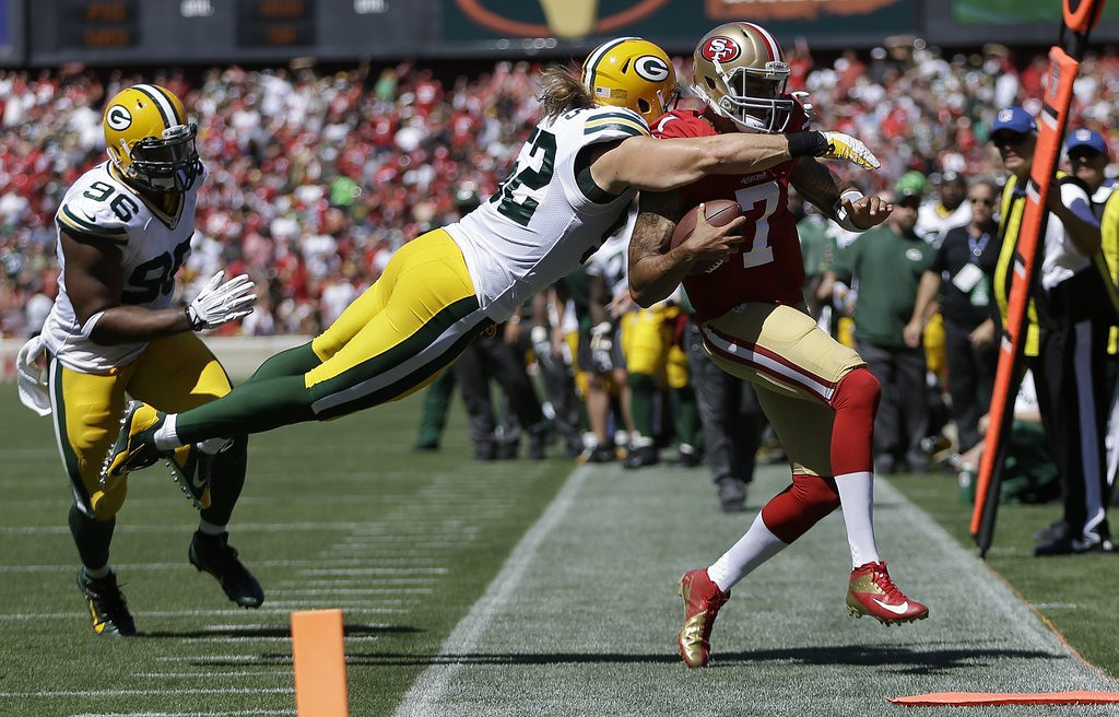 ". <p><b> Green Bay linebacker Clay Matthews could be facing a fine or suspension for his � </b> <p> A. Out of bounds hit on San Francisco�s Colin Kaepernick on Sunday  <p> B. Girlish slap at 49ers lineman Joe Staley  <p> C. Excessive posing for his next Fathead poster  <p><b><a href=\'http://www.twincities.com/sports/ci_24058516/green-bay-packers-clay-matthews-hit-sparks-war\' target=""_blank\"">HUH?</a></b> <p>    (AP Photo/Ben Margot)"