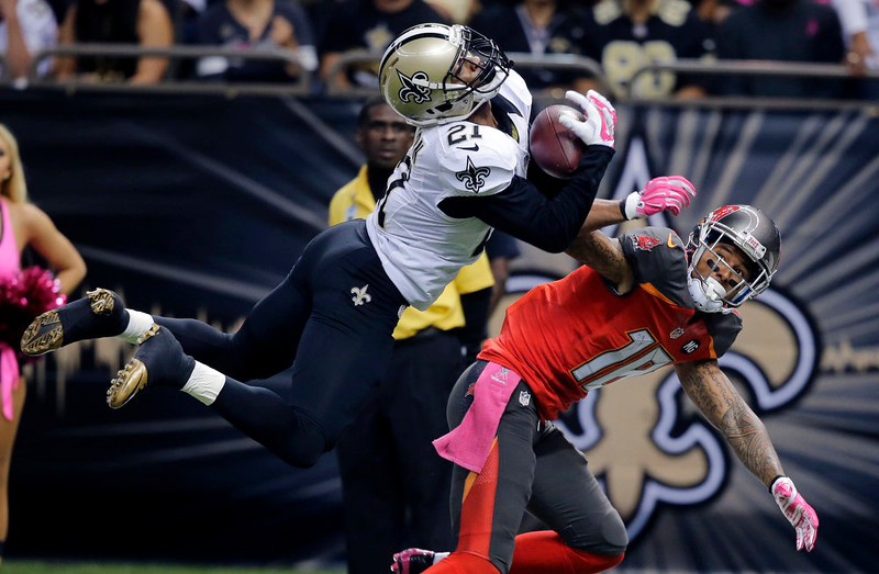 . New Orleans Saints cornerback Patrick Robinson (21) intercepts a pass intended for Tampa Bay Buccaneers wide receiver Louis Murphy (18) in the first half of an NFL football game in New Orleans, Sunday, Oct. 5, 2014. (AP Photo/Bill Haber)
