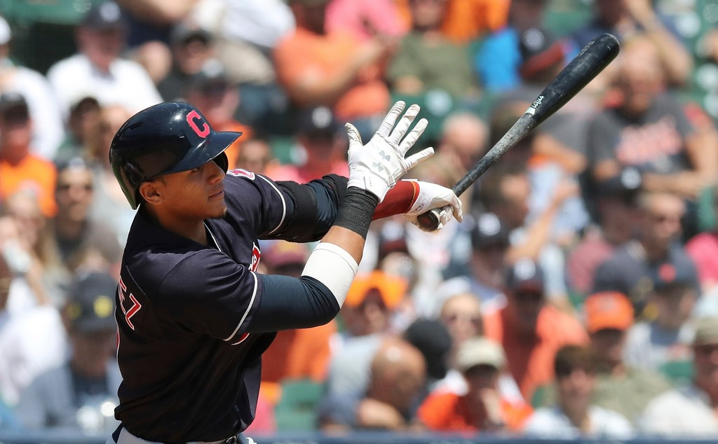 . Cleveland Indians\' Erik Gonzalez hits an RBI single during the fourth inning of a baseball game against the Detroit Tigers, Wednesday, May 16, 2018, in Detroit. (AP Photo/Carlos Osorio)