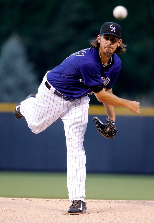 . Colorado Rockies starting pitcher Christian Bergman throws against the Los Angeles Dodgers during the first inning of a baseball game Monday, Sept. 15, 2014, in Denver. (AP Photo/Jack Dempsey)