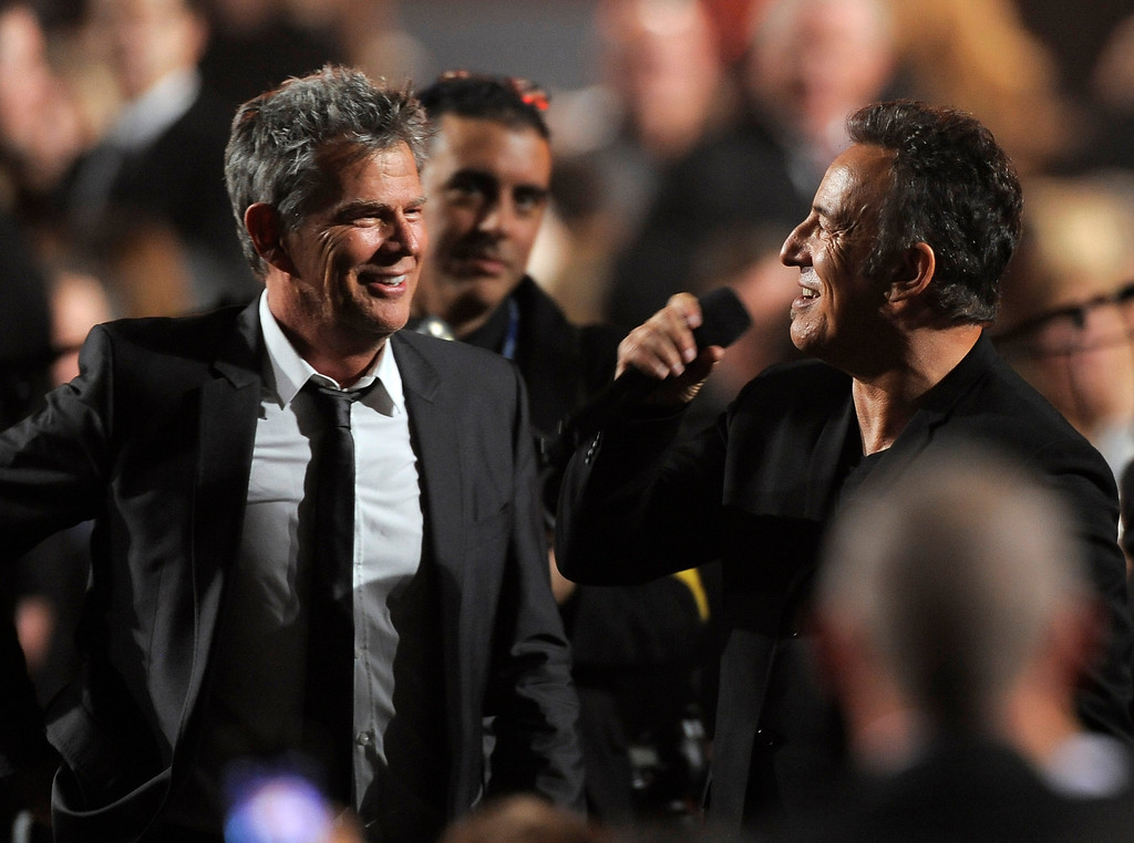 . David Foster, left, and honoree Bruce Springsteen are seen at the MusiCares Person of the Year tribute at the Los Angeles Convention Center on Friday Feb. 8, 2013, in Los Angeles. (Photo by Chris Pizzello/Invision/AP)