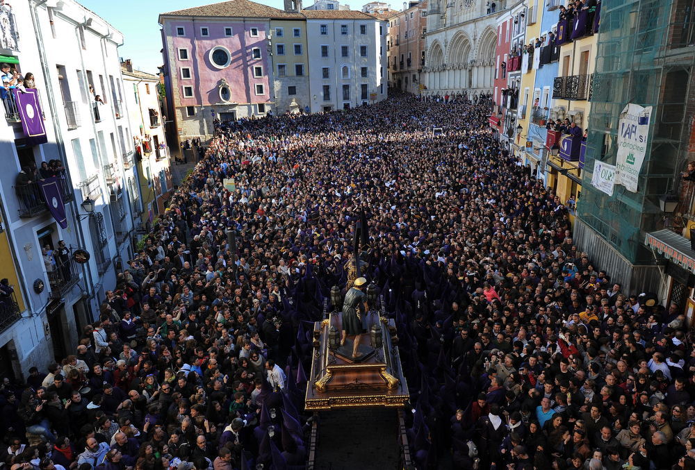 . Crowds watch as the Good Friday procession enters the Plaza Mayor on April 18, 2014 in Cuenca, Spain. Spain celebrates Holy Week with processions in most Spanish towns during the last week of Lent. (Photo by Denis Doyle/Getty Images)