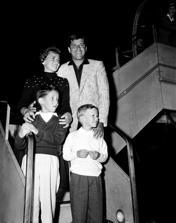 . Actor-comedian Jerry Lewis, top right, his wife, singer Patti, and their children Gary, 10, and Ronnie, 6, return to Hollywood, Ca., July 1955.  (AP Photo)
