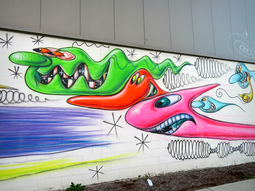 kenny scharf mural in the bronx on the side of Krinos food