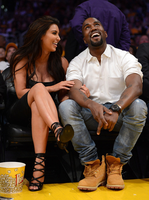 . LOS ANGELES, CA - MAY 12:  Kim Kardashian and Kanye West watch the video board from their courtside seats as the Los Angeles Lakers take on the Denver Nuggets in Game Seven of the Western Conference Quarterfinals in the 2012 NBA Playoffs on May 12, 2012 at Staples Center in Los Angeles, California.   (Photo by Harry How/Getty Images)