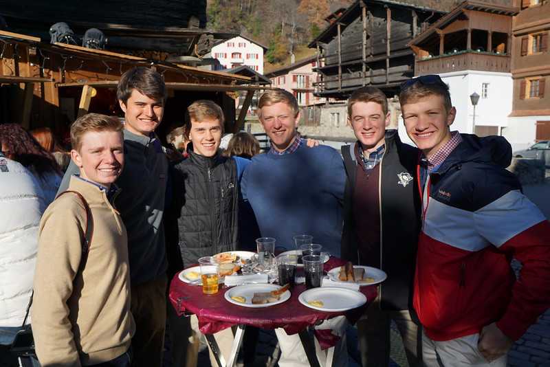 Landen, Matthew, Billy, John, Henry, and Cap enjoying a bratwurst at the market