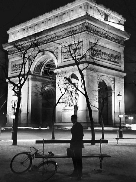 a break from riding his bike. Arc de Triomphe, Paris, France