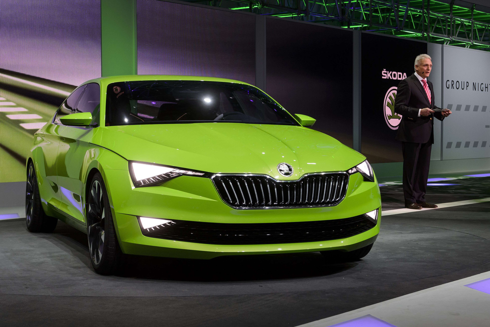 Description of . Winfried Vahland, chairman of Skoda Auto, presents the new Skoda Vision C concept car during a preview show by Volkswagen Group on March 3, 2014 on the eve of the press day of the Geneva Motor Show in Geneva. FABRICE COFFRINI/AFP/Getty Images