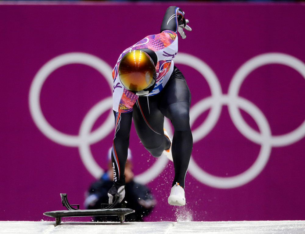 . John Daly of the United States starts his second run during the men\'s skeleton competition at the 2014 Winter Olympics, Friday, Feb. 14, 2014, in Krasnaya Polyana, Russia. (AP Photo/Natacha Pisarenko)