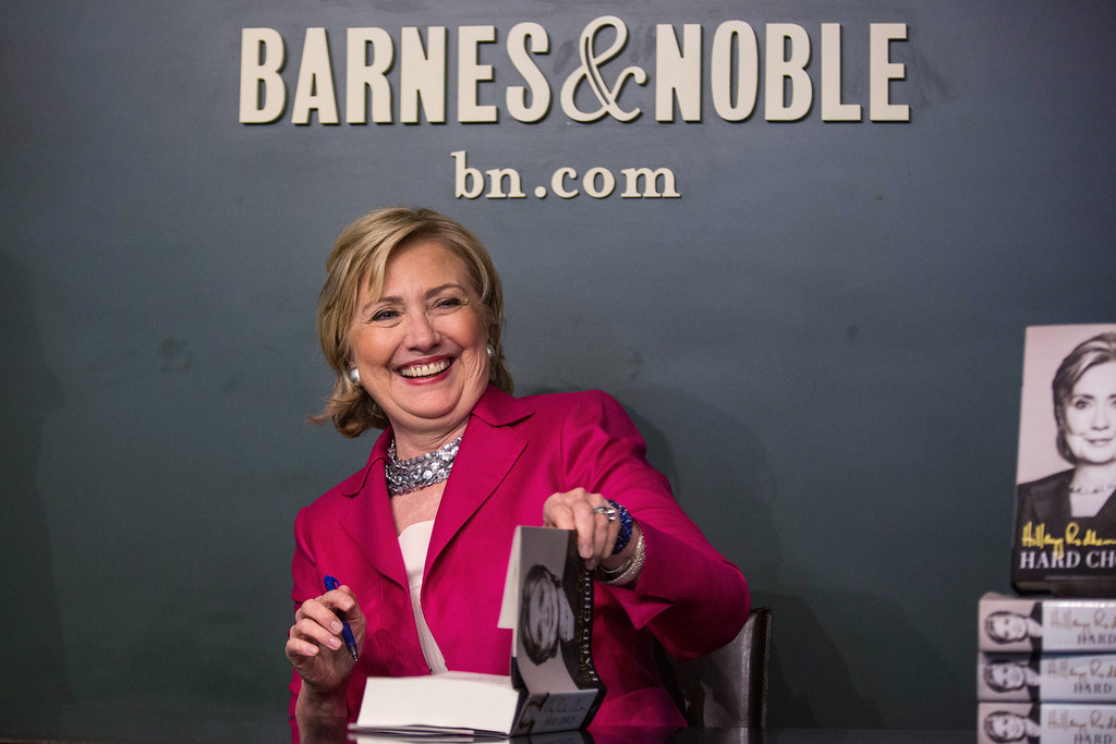 ". Former Secretary of State Hillary Clinton poses with her new book, ""Hard Choices\"" during a book signing at a Barnes & Noble on June 10, 2014 in New York City.   (Photo by Andrew Burton/Getty Images)"