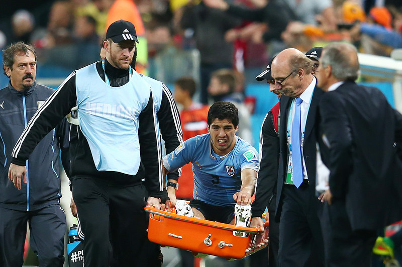 . Luis Suarez of Uruguay is stretchered off the pitch during the 2014 FIFA World Cup Brazil Group D match between Uruguay and England at Arena de Sao Paulo on June 19, 2014 in Sao Paulo, Brazil.  (Photo by Julian Finney/Getty Images)
