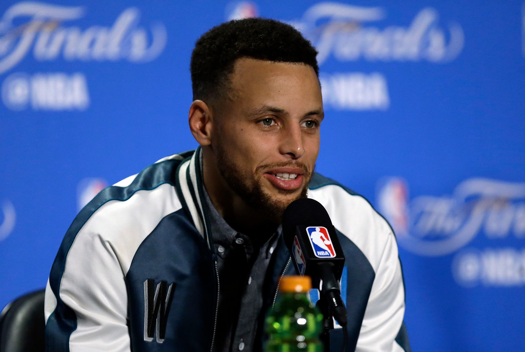 . Golden State Warriors\' Stephen Curry answers questions after Game 1 of basketball\'s NBA Finals against the Cleveland Cavaliers Thursday, June 1, 2017, in Oakland, Calif. (AP Photo/Ben Margot)
