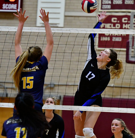 11/14/2018 Mike Orazzi | Staff Bristol Eastern's Gabriella Nozzolillo (17) and Woodstock Academy's Samantha Orlowski (15) during the Class L Semifinal State Girls Volleyball Tournament held at Windsor High School Wednesday night.