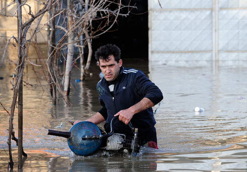 . A man salvages machines from his house in Sveti Nikole, 60 km (37 miles) northeast from capital Skopje, February 26, 2013. One man was drowned and several hundred homes in Macedonia were flooded on Tuesday as two days of heavy rain drenched farmland and caused power outages in the Balkan country, authorities said.  REUTERS/Ognen Teofilovski