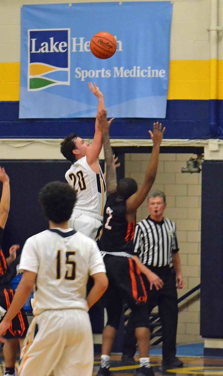 . Paul DiCicco - The News-Herald Wickliffe�s Bubba Turi shoots a running one hander against Orange.