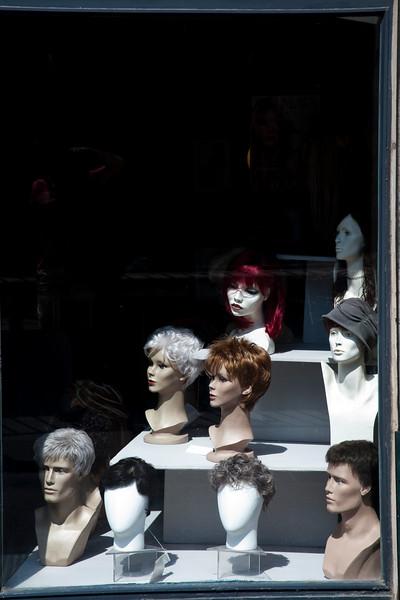 Wig shop window, town of Barcelona, autonomous commnunity of Catalonia, northeastern Spain