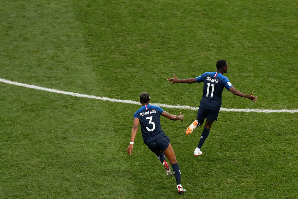 . France\'s Presnel Kimpembe and Ousmane Dembele celebrate at the end of the final match between France and Croatia at the 2018 soccer World Cup in the Luzhniki Stadium in Moscow, Russia, Sunday, July 15, 2018. (AP Photo/Rebecca Blackwell)