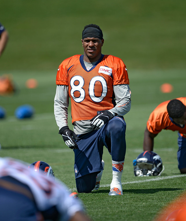 . Denver Broncos tight end Julius Thomas (80) stretches during day two of the Denver Broncos 2014 training camp July 25, 2014 at Dove Valley. (Photo by John Leyba/The Denver Post)