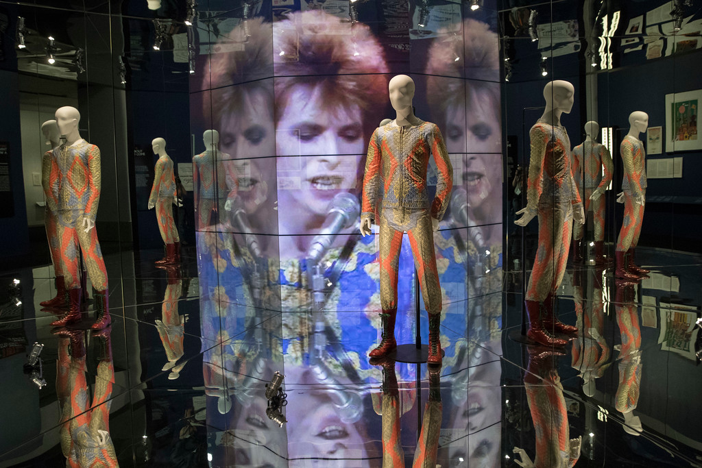 """. A quilted two piece suit worn for \""""Starman\"""" performance designed by Freddie Burretti is on display during the media preview of the \""""David Bowie is\"""" exhibit at the Brooklyn Museum, Wednesday, Feb. 28, 2018, in New York. The exhibit opens to the public on March 2 and runs through July 15. (AP Photo/Mary Altaffer)"""
