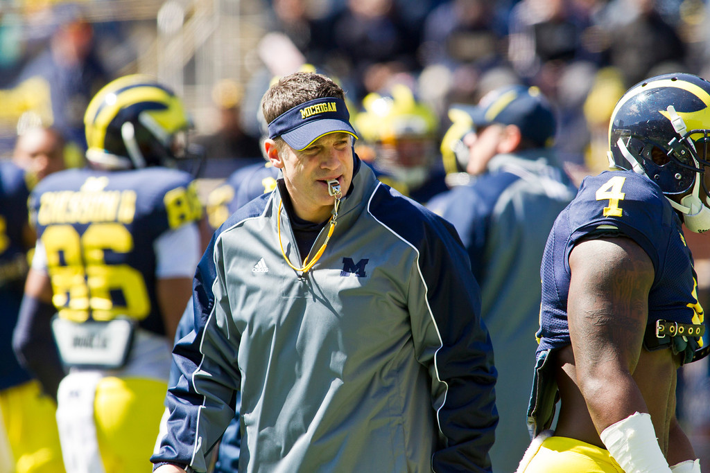 . Michigan offensive coordinator Doug Nussmeier watches his players run through drills at his whistle, during the football team\'s annual spring game, Saturday, April 5, 2014, in Ann Arbor, Mich. (AP Photo/Tony Ding)