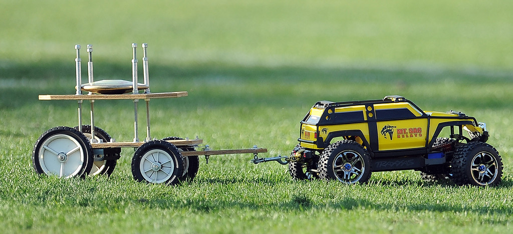 . A remote controlled truck carries discus across the field during the Mt. SAC Relays in Hilmer Lodge Stadium on the campus of Mt. San Antonio College on Saturday, April 20, 2012 in Walnut, Calif.    (Keith Birmingham/Pasadena Star-News)