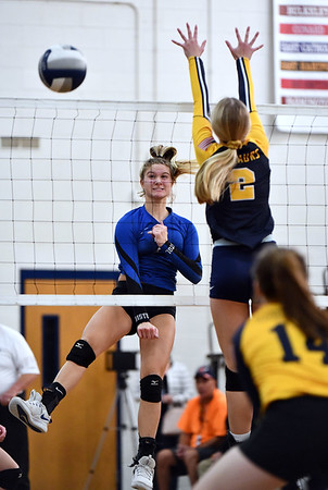 11/16/2019 Mike Orazzi | StaffrBristol Easterns Zoe Lowe (7) and Woodstock Academy's Amelia Large (2) during the 2019 State Girls Volleyball Tournament Class L Quarterfinals at BEHS in Bristol Saturday.