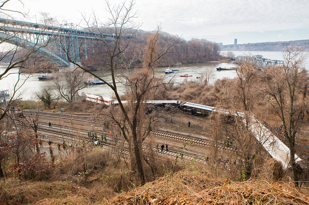 . Emergency crews respond after Metro-North train derailed near the Spuyten Duyvil station December 1, 2013 in the Bronx borough of New York City. Multiple injuries and several deaths were reported after the seven car train left the tracks as it was heading to Grand Central Terminal along the Hudson River line.  (Photo by Christopher Gregory/Getty Images)
