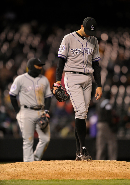 . DENVER, CO. - APRIL 16:  Starter Jeff Francis smoothed the dirt on the mound as he waited for manager Walt Weiss to take him from the game in the fifth inning. The Colorado Rockies hosted the New York Mets in the second game of a doubleheader Tuesday night, April 16, 2013. Monday night\'s game was snowed out at Coors Field.  Photo By Karl Gehring/The Denver Post)