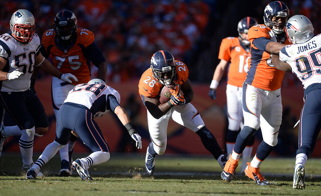 . Denver Broncos running back Montee Ball (28) with a 4-yard pick up in the third quarter. The Denver Broncos take on the New England Patriots in the AFC Championship game at Sports Authority Field at Mile High in Denver on January 19, 2014. (Photo by AAron Ontiveroz/The Denver Post)