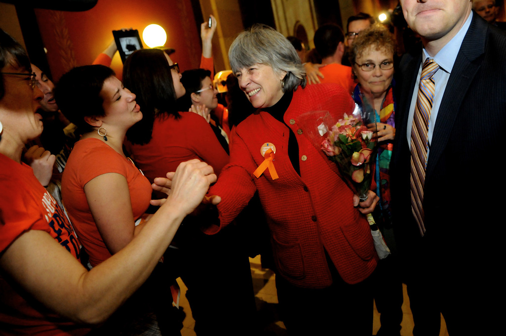 . House Rep. Karen Clark, DFL-Minneapolis, the sponsor of the bill, is hugged by supporters as she leaves the chambers of the Minnesota House of Representatives. (Pioneer Press: Jean Pieri)