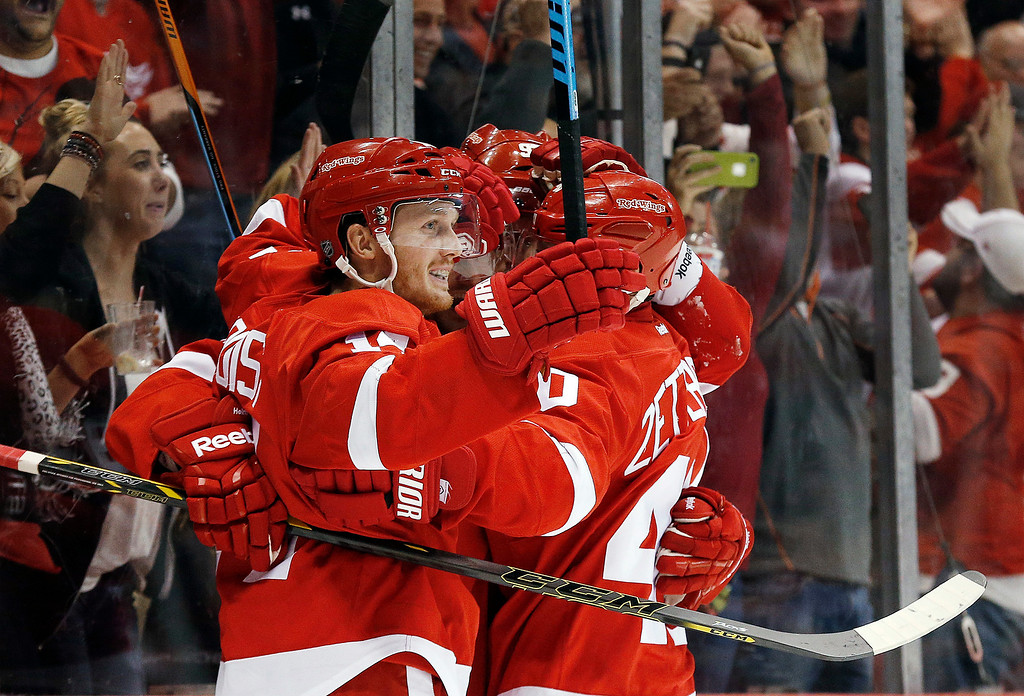 . Detroit Red Wings center Gustav Nyquist, of Sweden, celebrates his goal against the Boston Bruins with teammates in the second period of a NHL hockey game in Detroit Thursday, Oct. 9, 2014. (AP Photo/Paul Sancya)