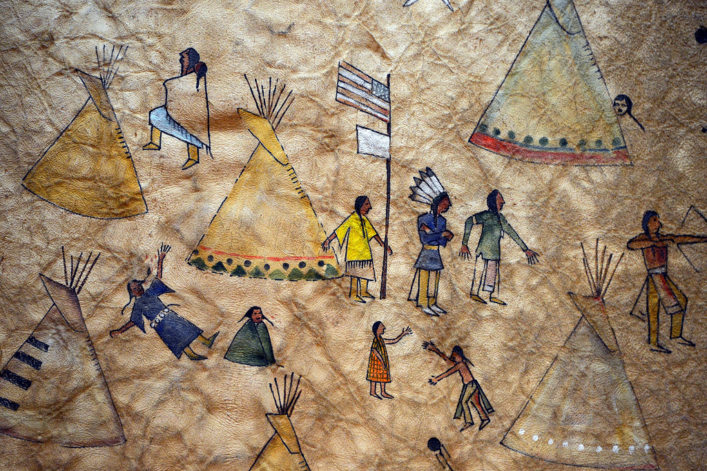 . A painting depicting the 1864 Sand Creek massacre on a buffalo skin hangs on a wall of Sand Creek Massacre Descendants Trust attorney Larry Derryberry  in Oklahoma City, Oklahoma November 30th, 2012.  (Andy Cross/The Denver Post)