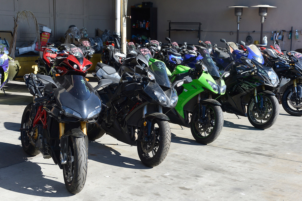 . The Taskforce for Regional Autotheft Prevention just broke up a high-end theft/chop shop motorcycle ring. The bikes are parked in a tow yard in North Hollywood, CA. 12/20/2013, photo by (John McCoy/Los Angeles Daily News)