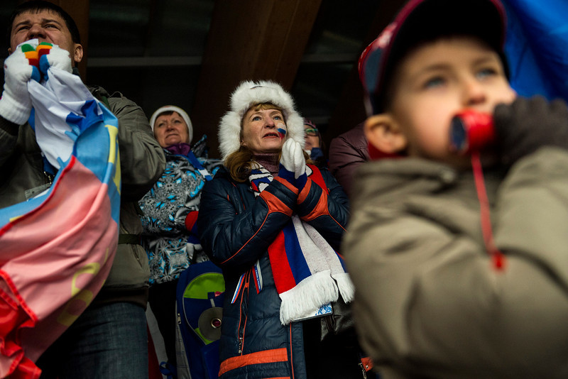 . Russian fans cheer on Elena Nikitina, of Russia, during the women\'s skeleton competition at Sanki Sliding Center during the 2014 Sochi Olympics Friday February 14, 2014. Pikus-Pace finished with a time of 3:53.86. (Photo by Chris Detrick/The Salt Lake Tribune)