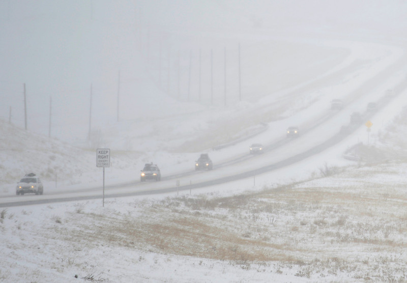 . Traffic moves slow along Highway 93, February, 21, 2013, near Arvada. The metro area was slowed by overnight snow, roads are snow packed, icy, and lane recognition is a problem along some stretches. (Photo By RJ Sangosti/The Denver Post)