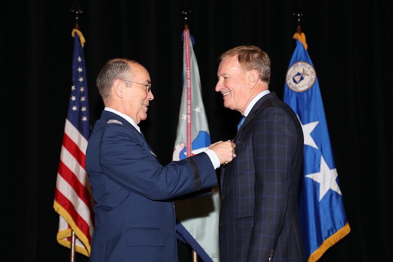Retired Air Force Colonel, and CAP Senior Member Kenneth Goss receiving the Distinguished Service Award.  He distinguished himself by willingly stepping in when the volunteer Chief of Development resigned.  He worked with the new volunteer chief to develop a strategy to move the program forward.  Photo by Susan Schneider, CAPNHQ