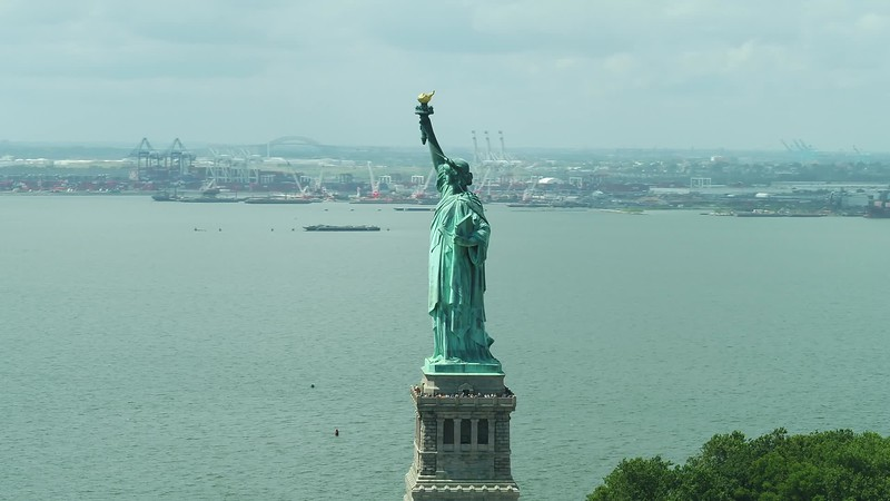 Cinematic aerial clip Statue of Liberty New York