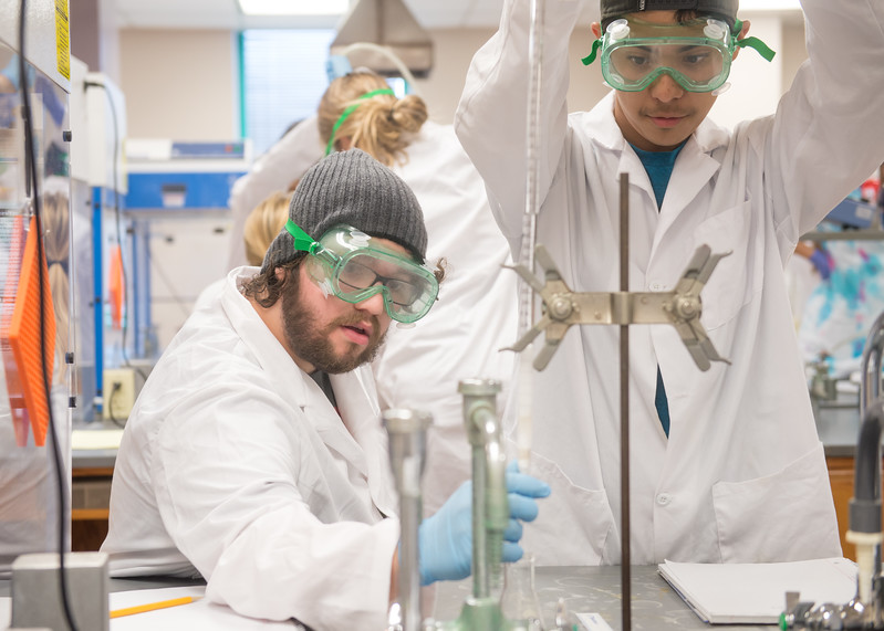 Michael McCampbell and Elias Trevino push air through different materials for a Column Chromatography lab in Organic Chemistry I.