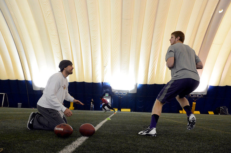 . Former Denver Broncos quarterback, Jake Plummer, left,  coaches former Kansas State star quarterback, Collin Klein, inside the South Suburban Parks and Recreation\'s Sport Dome in Centennial, Colorado, Thursday morning, February 14th, 2013.  Plummer has spent weeks with Klein preparing him for the upcoming NFL Scouting Combine in Indianapolis, Indiana February 20th thru February 26th 2013. (Photo By Andy Cross / The Denver Post)