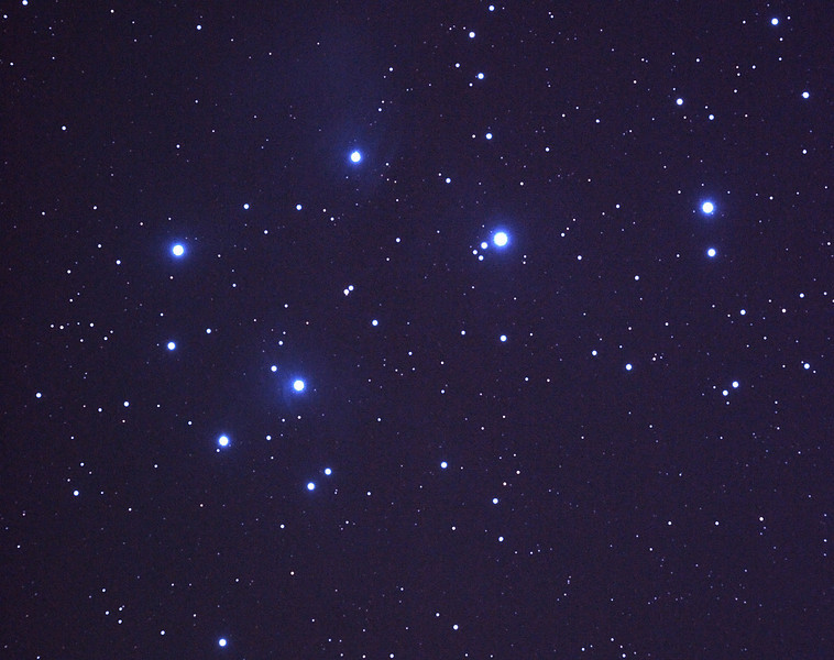 Messier M45 Pleiades, Seven Sisters, Subaru or Matariki - 14/11/2010 (Reprocessed RAW stack)   One of the most well known of open clusters, the Pleiades or Seven Sisters, located in Taurus at ~400 Light Years distance is amongst the nearest star clusters to Earth. It is the most obious cluster to the naked eye. It has been named in many ancient cultures. The cluster is dominated by hot blue and extremely luminous stars that have formed within the last 100 million years. Dust that forms a faint reflection nebulosity around the brightest stars was thought at first to be left over from the formation of the cluster, but is now known to be an unrelated dust cloud in the interstellar medium that the stars are currently passing through.  I revisted this stack of images in early 2012 and reprocessed it with the benefit of a bit more post-processing experience.  DeepSkyStacker 3.3.2 Stacked 70% of 8 Images ISO 800 120 Sec, 3 DARK, 5 BIAS, 0 FLATS, Post-processed by Photoshop CS5  Things to note are that the image is more balanced with less noise evident compared to my original processing. I tried to ensure that the background sky (from skyglow) was not too bright and the central portion not over-exposed by paying more attention to stretching the mid-tones rather than squashing the whole range as I had done initially. However, the nebulosity is poorly shown mainly due to a lack of light frames and the high skyglow level for this northern object. Oh for dark country skies!   Limited cropping is possible due to the size of this object so some spherical aberration is evident near the outer edges of the image. Focused using a Bahtinov Mask.   Telescope - Apogee OrthoStar LOMO 80/480 with Hotech SCA T-Adapter, Hutech IDAS LPS-P2 filter, Canon 400D DSLR, Ambient xxC (not recorded). Mount - Skywatcher NEQ6 Pro. Guidescope - Orion ShortTube 80 with Star Shoot Auto Guider.