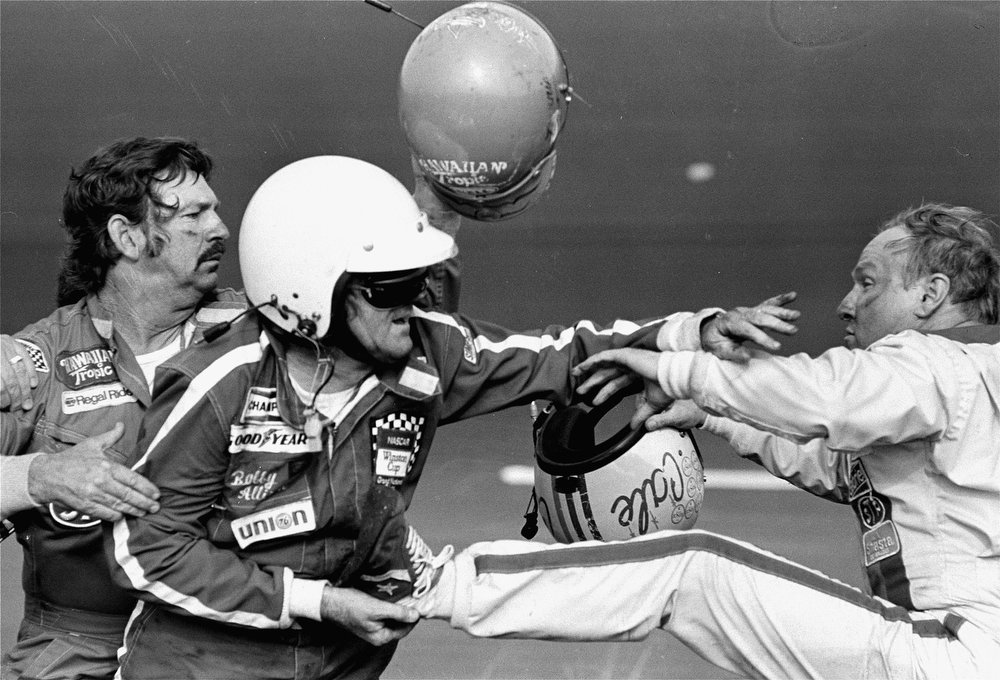. Bobby Allison holds race driver Cale Yarborough\'s foot after Yarborough kicked him following an argument Feb. 18, 1979 when Yarborough stopped his car during the final lap of the Daytona 500.  Allison\'s brother Donnie was involved in a wreck with Yarborough on the final lap which made brother Bobby stop.  (AP Photo/Ric Feld)