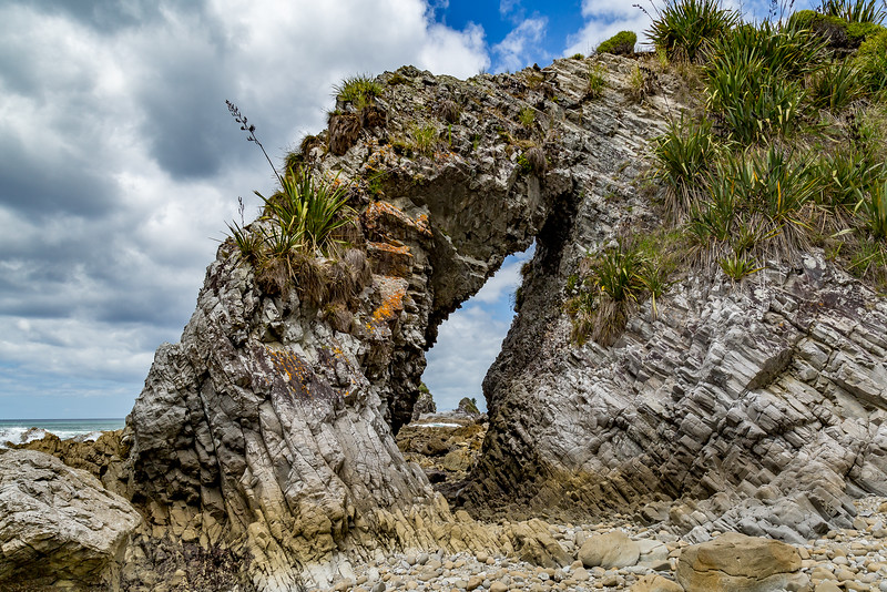 Steinbogen an der Mangawhai Beach