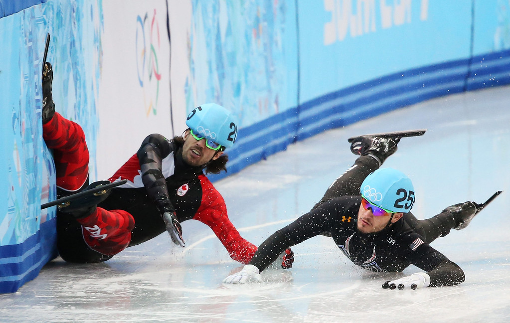 . Charles Hamelin (L) of Canada and Eduardo Alvarez of the USA fall in quarter final 3 in men\'s 1000m at the Short Track events in the Iceberg Skating Palace at the Sochi 2014 Olympic Games, Sochi, Russia, 15 February 2014.  EPA/TATYANA ZENKOVICH