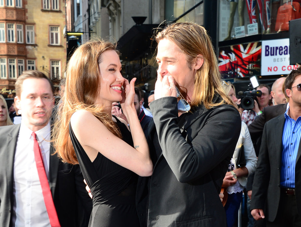. Angelina Jolie and Brad Pitt arrive at the World Premiere of \'World War Z\' at the Empire Cinema in London, Sunday June 2nd, 2013. (Photo by Jon Furniss/Invision/AP Images)