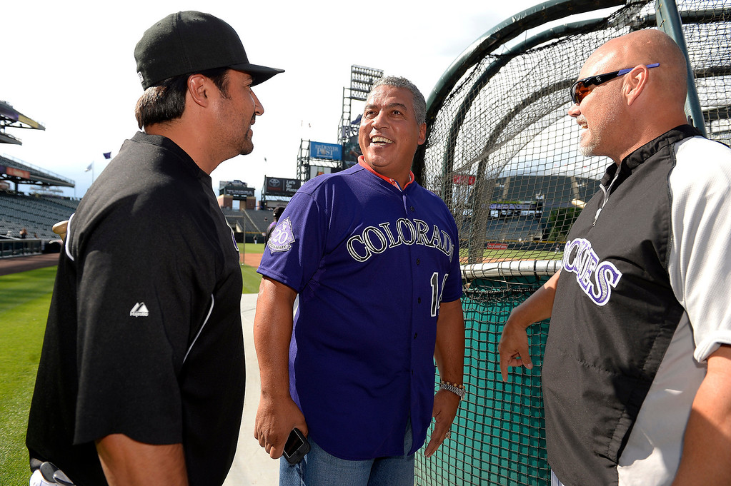 . Colorado Rockies Vinny Castilla (L) Andres Galarraga (M) and Dante Bichette share a laugh during an open workout session for the fans July 18, 2013 at Coors Field. (Photo By John Leyba/The Denver Post)