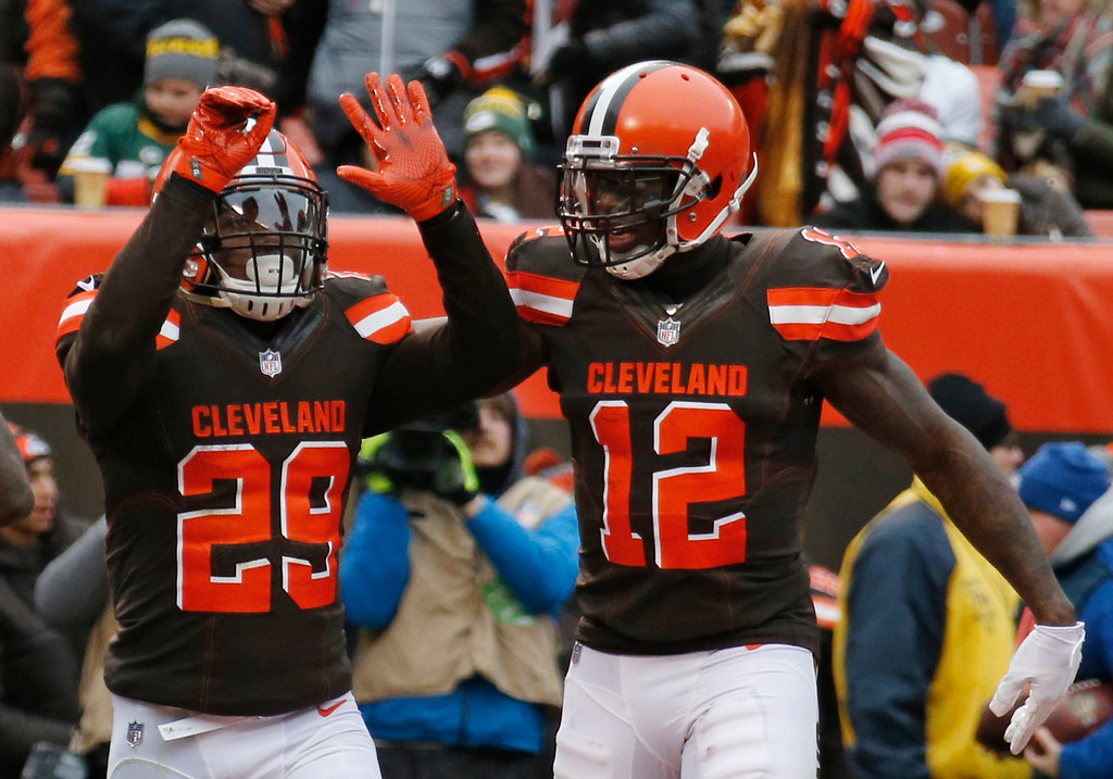 . Cleveland Browns running back Duke Johnson (29) celebrates with Josh Gordon (12) after Johnson scored a 7-yard touchdown in the first half of an NFL football game against the Green Bay Packers, Sunday, Dec. 10, 2017, in Cleveland. (AP Photo/Ron Schwane)