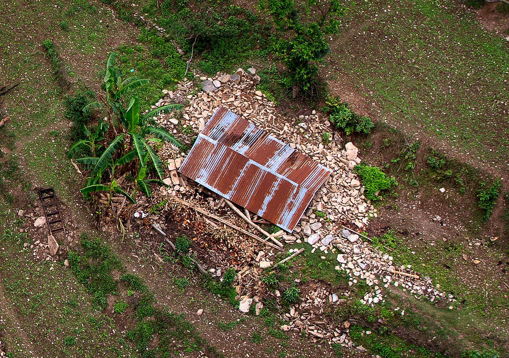 . A house on the higher reaches of mountains, destroyed in Saturday\'s earthquake is seen from a helicopter near Dhadingbesti, in Nepal, Wednesday, April 29, 2015.  The first aid shipments reached a hilly district near the epicenter of Nepal\'s earthquake, a U.N. food agency official said, and distribution of food and medicine would start Wednesday, five days after the quake struck. (AP Photo/Manish Swarup)